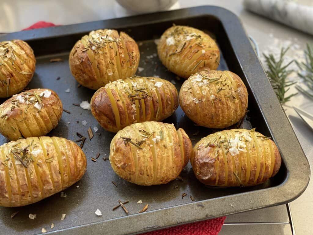 Tray of baked Hasselback Potatoes