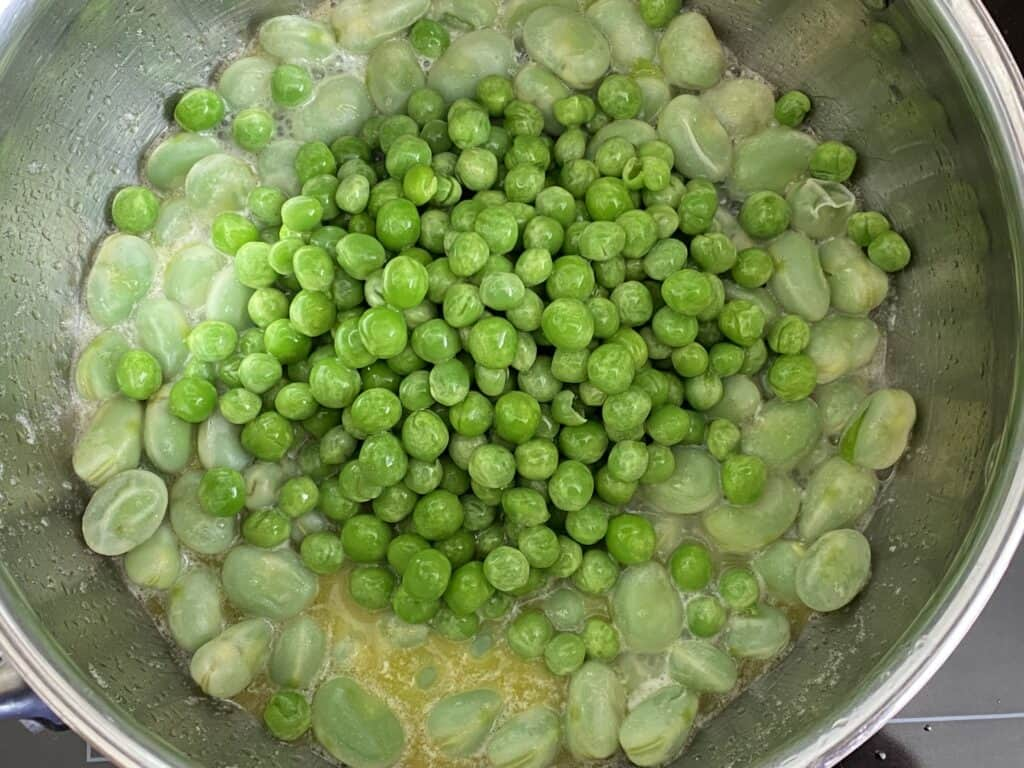 Add the peas to the beans and cook for a further 5 mins